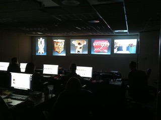 Jury with artwork slides showing in a dark room